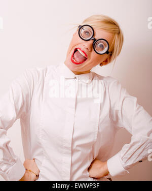 bookworm, cute young woman in glasses, blond hair, teenage - Stock Photo