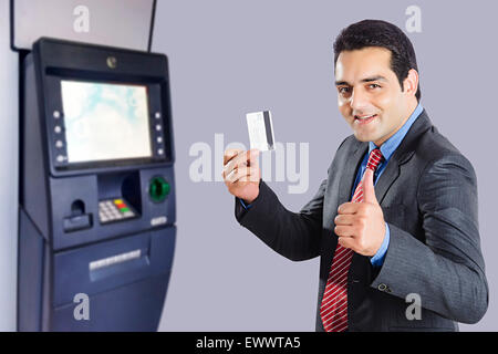 1 indian man atm machinery credit card showing stock photo 84743291 1 indian business man credit card showing stock photo reheart Images