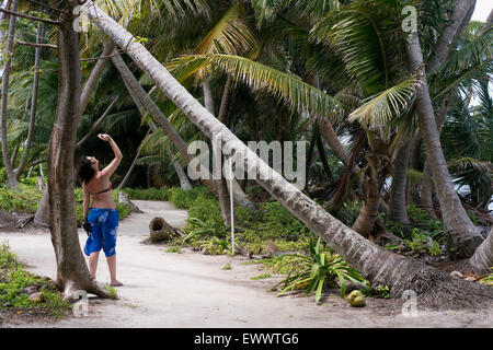 A woman taking a photo in Belize - Stock Photo
