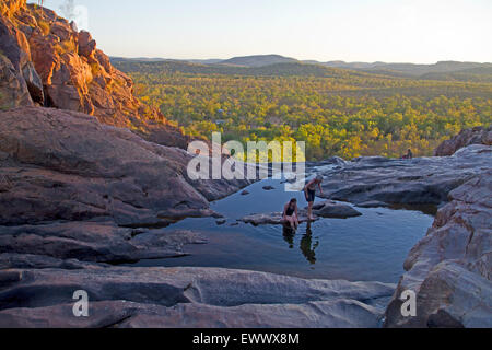 Cooling off in the upper pools at Gunlom - Stock Photo