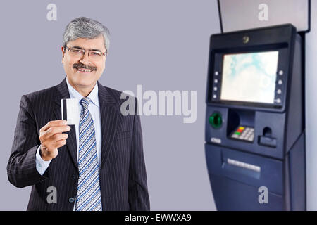 1 indian business man atm machine with credit card withdrawal 1 indian business man credit card showing stock photo reheart Choice Image