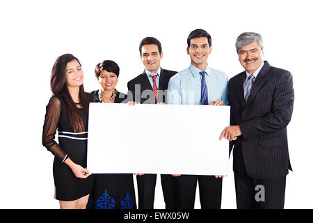 4 indian Business partner showing Message Board - Stock Photo
