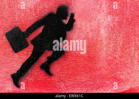 Graphical representation of a runner businessman on a plastered wall. - Stock Photo
