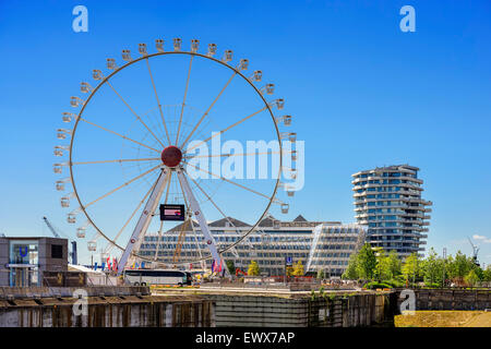 Unilever headquarters, Marco Polo Tower and Ferris Wheel in HafenCity, Hamburg, Germany - Stock Photo