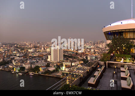 Cityscape with Jewelry Trade Center at dawn, view from Millennium Hilton, Chao Phraya river, Bangkok, Thailand - Stock Photo