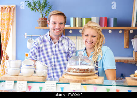 Portrait Of Couple Running Cafe Together - Stock Photo