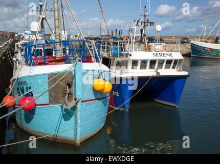 Boats in the harbour at Seahouses, Northumberland, England, UK - Stock Photo