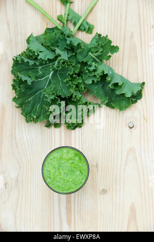 Raw green leaf and fruit smoothie in a glass - Stock Photo