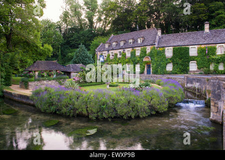 Swan Hotel in Bibury, Cotswolds, Gloucestershire, England - Stock Photo