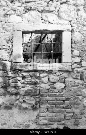 old window grille of a ruined castle in Italy - Stock Photo