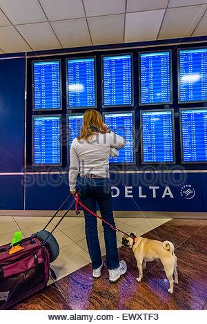 Flight departure screens, Hartsfield-Jackson Atlanta International Airport, Atlanta, Georgia USA. - Stock Photo