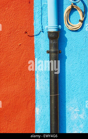 Pipes and wires on blue and rust coloured wall Burano Venetian Lagoon Veneto Italy Europe