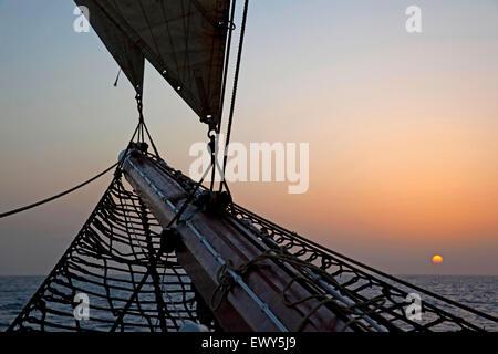 Safety net under bowsprit of three-masted topsail schooner Oosterschelde sailing the Atlantic Ocean near Cape Verde - Stock Photo