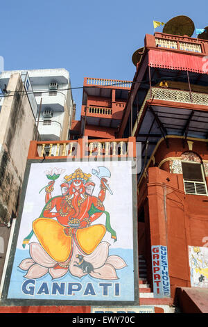 Entrance and wall mural to Ganpati Guest House cheap / budget accommodation with rooftop restaurant overlooking - Stock Photo