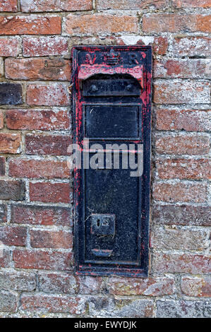 Blocked rural post box in wall - Stock Photo