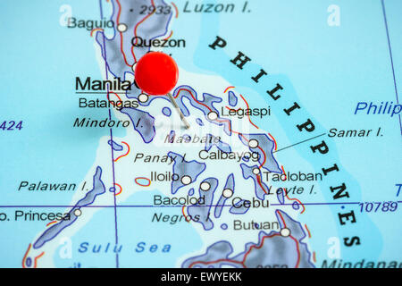 Close-up of a red pushpin on a map of Philippines - Stock Photo