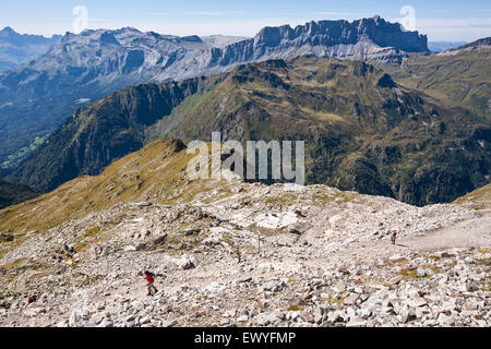 Hikers above Chamonix-Mont Blanc valley, France. - Stock Photo