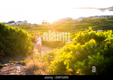 Girl jogging on trail, Corsica, France - Stock Photo