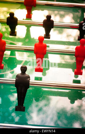 Football Table with Red and Black Figures - Stock Photo