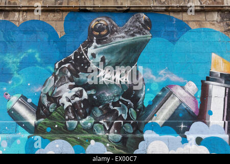Frog with spray cans, graffiti, Danube Canal, Vienna, Austria - Stock Photo