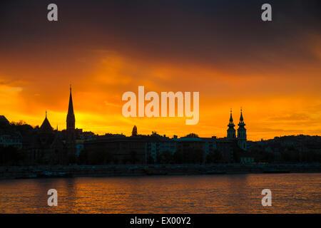 Budapest sunset, Buda part with Calvinist church (left) and Church Szent Anna templon (right), Hungary, Europe - Stock Photo