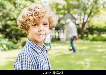 Portrait of cute boy in garden