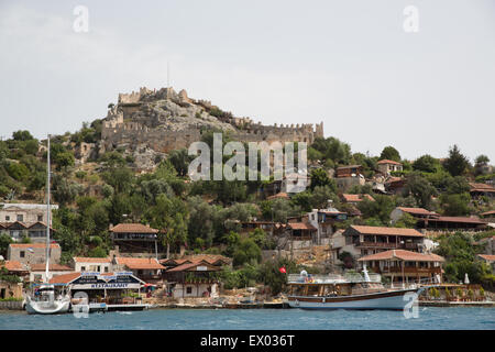 Castle and waterfront at Kalekoy, Lycian way, Kalekoy, Demre, Simena, Turkey - Stock Photo