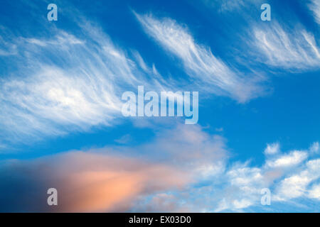 Wispy Cloud Formations at Dusk Amble by the Sea Northumberland England - Stock Photo