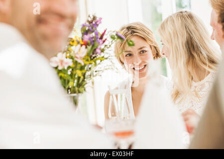Adults chatting at family birthday party - Stock Photo