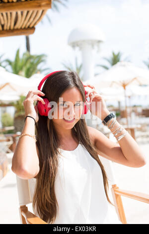 Portrait of young woman listening to headphones, Ibiza, Spain - Stock Photo