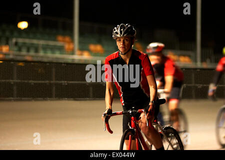 Cyclists cycling on track at velodrome - Stock Photo