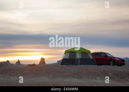 Tent and off road vehicle in front of Trona Pinnacles at sunset, Trona, California, USA - Stock Photo