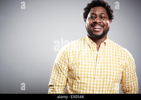 Studio portrait of mid adult businessman laughing - Stock Photo