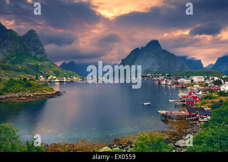 Reine. Scenic town of Reine by the fjord on Lofoten Islands in Norway. - Stock Photo