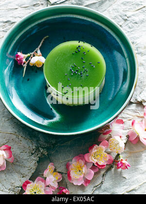 Still life with bowl of Japanese green tea cheesecake - Stock Photo