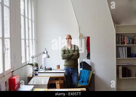 Mature man in creative studio, portrait - Stock Photo