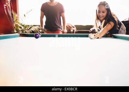 Two young adult friends playing pool,  Lake Atitlan, Guatemala - Stock Photo