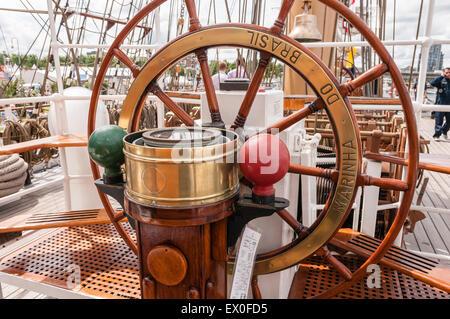 Belfast, Northern Ireland, UK. 02nd July, 2015. Ships helm and compass on the Brazilian sailing ship the Cisne Branco - Stock Photo