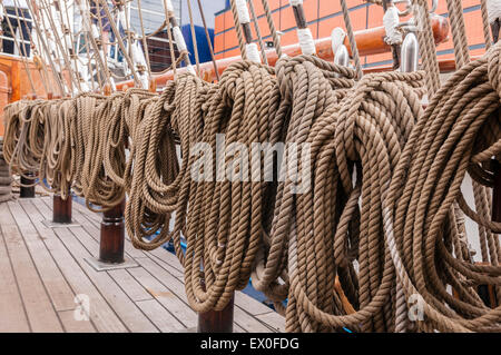 Belfast, Northern Ireland, UK. 02nd July, 2015. Ropes coiled up on board a sailing ship. Credit:  Stephen Barnes/Alamy - Stock Photo
