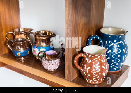 Earthenware jugs with a squiggle and dot glaze - Stock Photo