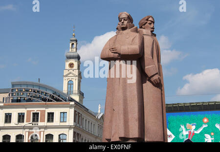 Latvian Riflemen Monument and the Town Hall building in Riga - Stock Photo