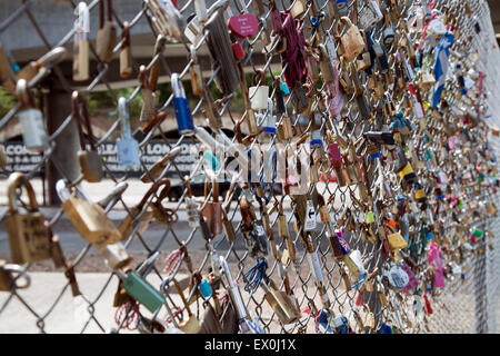 Love Locks on Fence in Shoreditch - London UK - Stock Photo