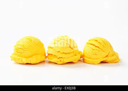 Scoops of orange mango ice cream - Stock Photo