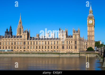A view of the magnificent Palace of Westminster over the River Thames in London.  The towers of Westminster Abbey - Stock Photo