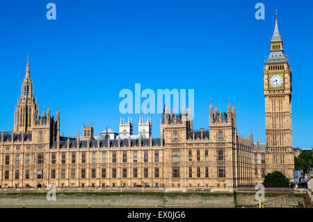 A view of the magnificent Palace of Westminster in London.  The towers of Westminster Abbey can be seen in the distance. - Stock Photo