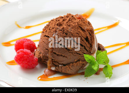 Chocolate vanilla ice cream drizzled with caramel - Stock Photo