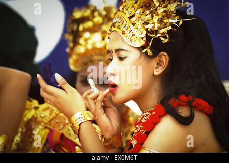 A traditional dancer preparing with makeup backstage during the Jakarta Highland Gathering 2004. - Stock Photo