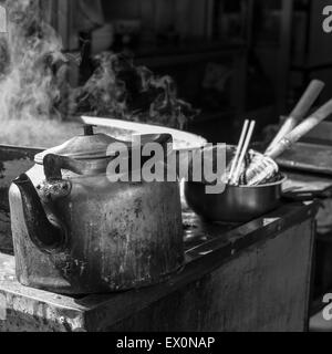 Steaming pot and teapot at food stand in Muslim Market, Xi'an, China - Stock Photo