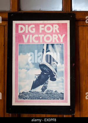 Vintage WW2 propaganda posters on the station platform at Loughborough, on The Great Central Railway, Leicestershire,Britain. - Stock Photo