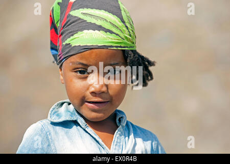 Close up portrait of Creole girl wearing headscarf on the island of Santiago, Cape Verde / Cabo Verde, Western Africa - Stock Photo